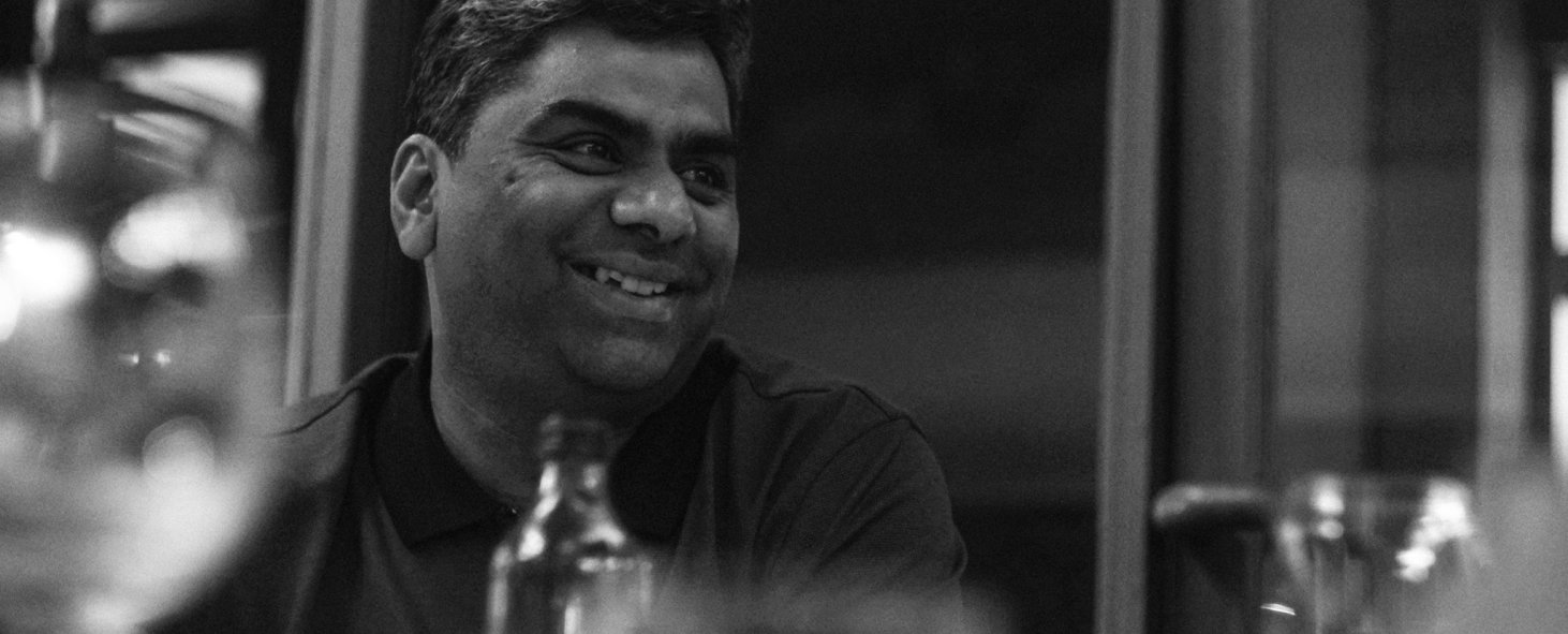 Chakri Gottemukkala, CEO of o9 Solutions and chief engineer of o9's Planning Platform, smiling in a meeting