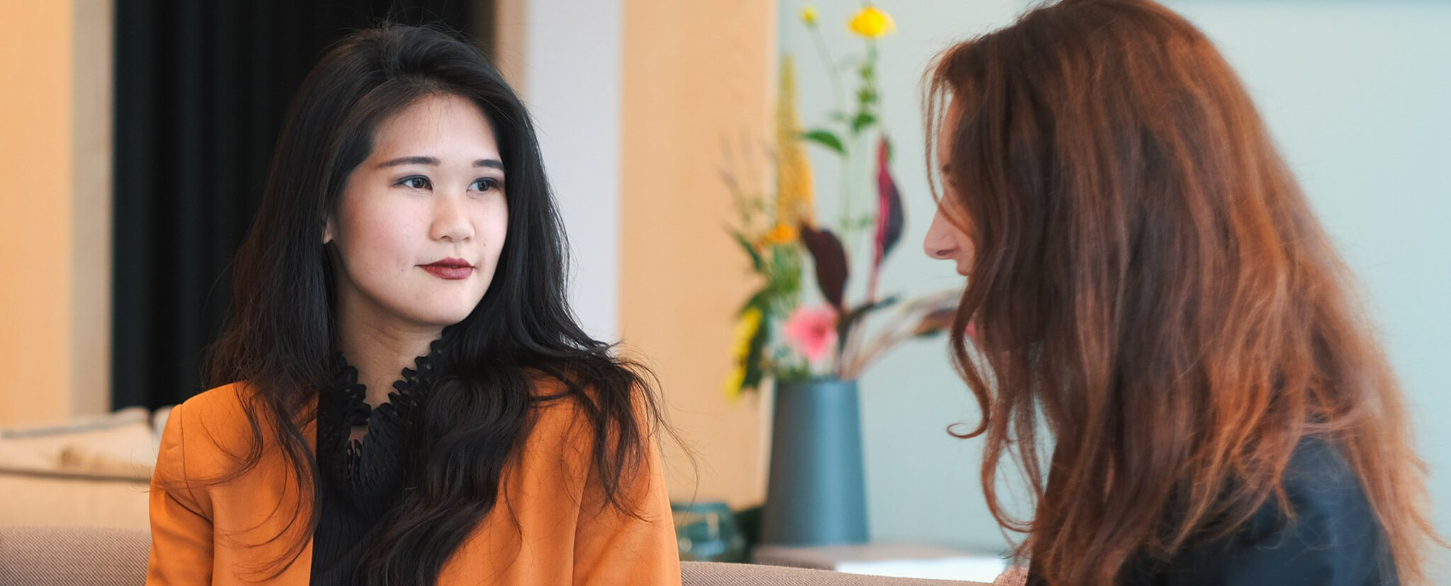 o9 employees: Joanne Lin, innovation manager, talking to Alexia Marcazzan, Global Innovation Strategist